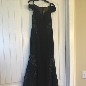 Dillard's formal black dress with some lace fabric